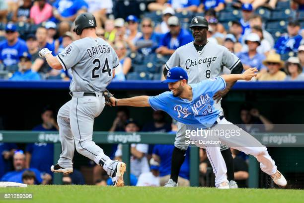 Eric Hosmer of the Kansas City Royals completes the double play against Matt Davidson of the Chicago White Sox during the fourth inning at Kauffman...