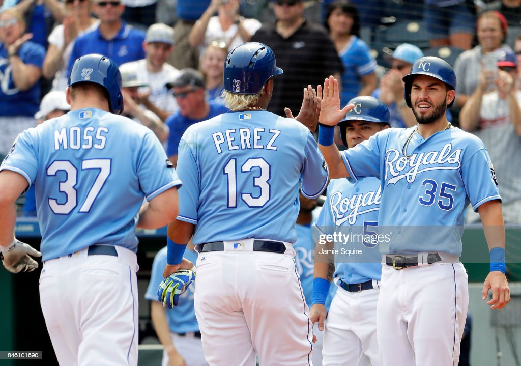 Eric Hosmer #35 of the Kansas City Royals congratulates Salvador Perez #13 and Brandon Moss #37 as they cross the plate to score after Moss hit a grand slam home run during the 1st inning of the game against the Chicago White Sox at Kauffman Stadium on September 12, 2017 in Kansas City, Missouri.