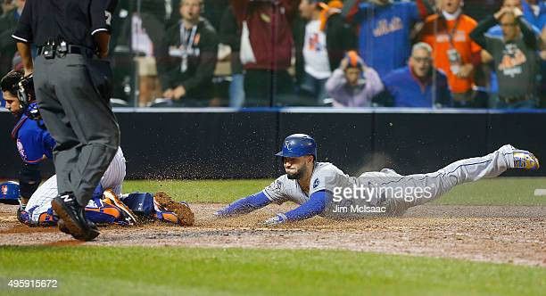 Eric Hosmer of the Kansas City Royals dives home to score a game tying ninth inning run against the New York Mets during game five of the 2015 World...