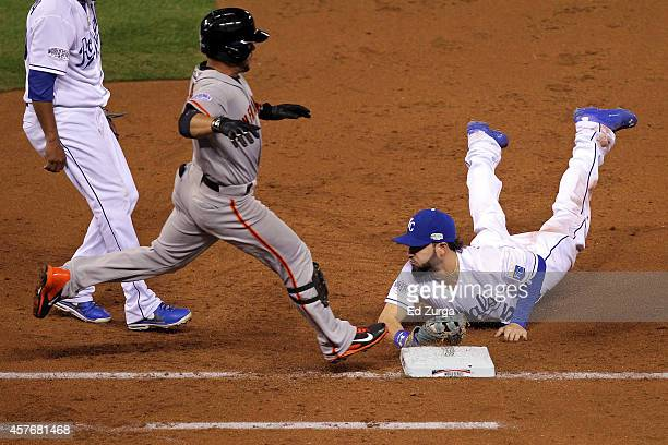 Eric Hosmer of the Kansas City Royals dives to tag out Gregor Blanco of the San Francisco Giants in the third inning during Game Two of the 2014...
