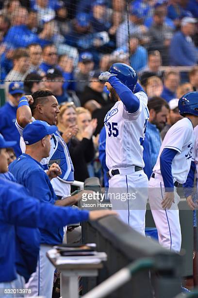 Eric Hosmer of the Kansas City Royals flexes his muscle with teammate Salvador Perez while celebrating after a home run in the third inning of the...
