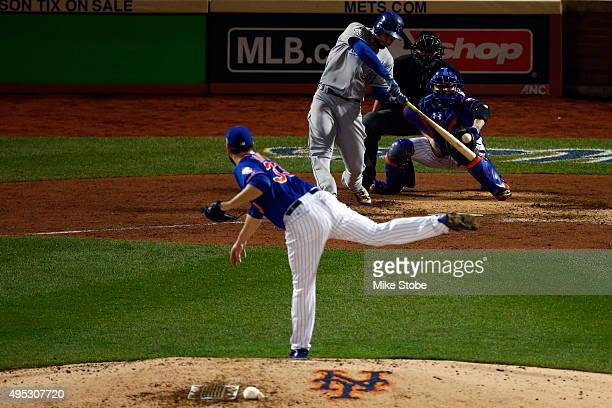 Eric Hosmer of the Kansas City Royals hits a double in to left field in the ninth inning to score Lorenzo Cain against Matt Harvey of the New York...