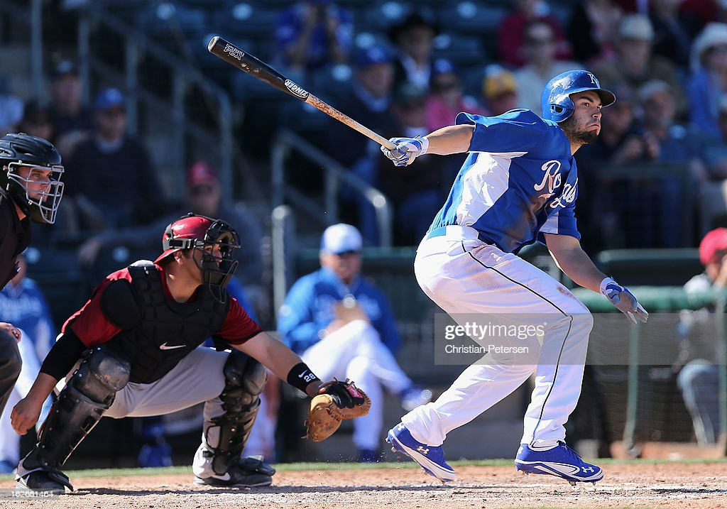Eric Hosmer #35 of the Kansas City Royals hits a RBI ground ball out against the Arizona Diamondbacks during the fourth inning of the spring training game at Surprise Stadium on February 25, 2013 in Surprise, Arizona.