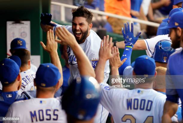 Eric Hosmer of the Kansas City Royals is congratulated by teammates in the dugout after an official review confirmed he hit a threerun home run...
