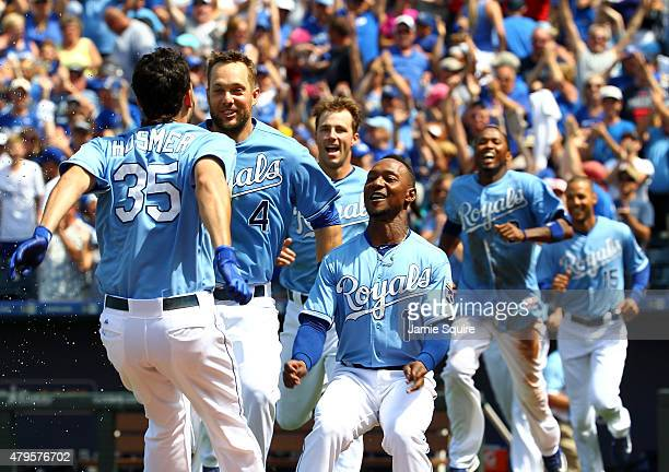 Eric Hosmer of the Kansas City Royals is mobbed by teammates after driving in the game-winning run in the bottom of the 9th inning against the...