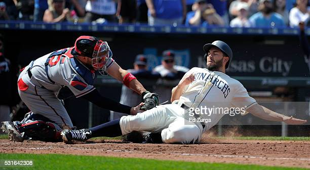 Eric Hosmer of the Kansas City Royals is tagged out by Tyler Flowers of the Atlanta Braves as he tries to score in the sixth inning at Kauffman...
