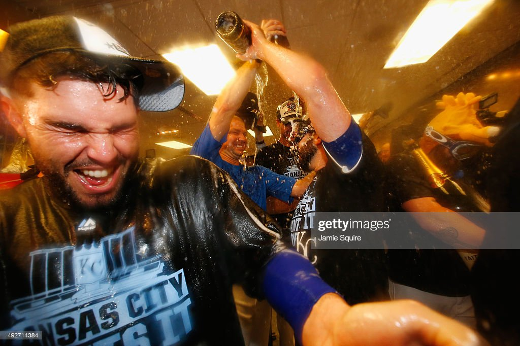 Eric Hosmer #35 of the Kansas City Royals, left, celebrates with teammates in the clubhouse after defeating the Houston Astros 7-2 in game five of the American League Divison Series at Kauffman Stadium on October 14, 2015 in Kansas City, Missouri.