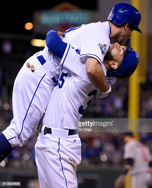 Eric Hosmer of the Kansas City Royals lifts up Billy Burns after Burns hit a sacrifice fly scoring Raul Mondesi to give the Royals as 43 win in...
