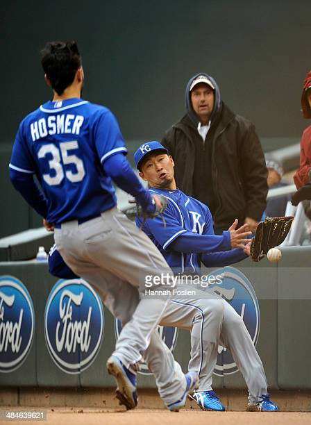 Eric Hosmer of the Kansas City Royals looks on as teammate Norichika Aoki misses a catch in foul territory during the seventh inning of the game...