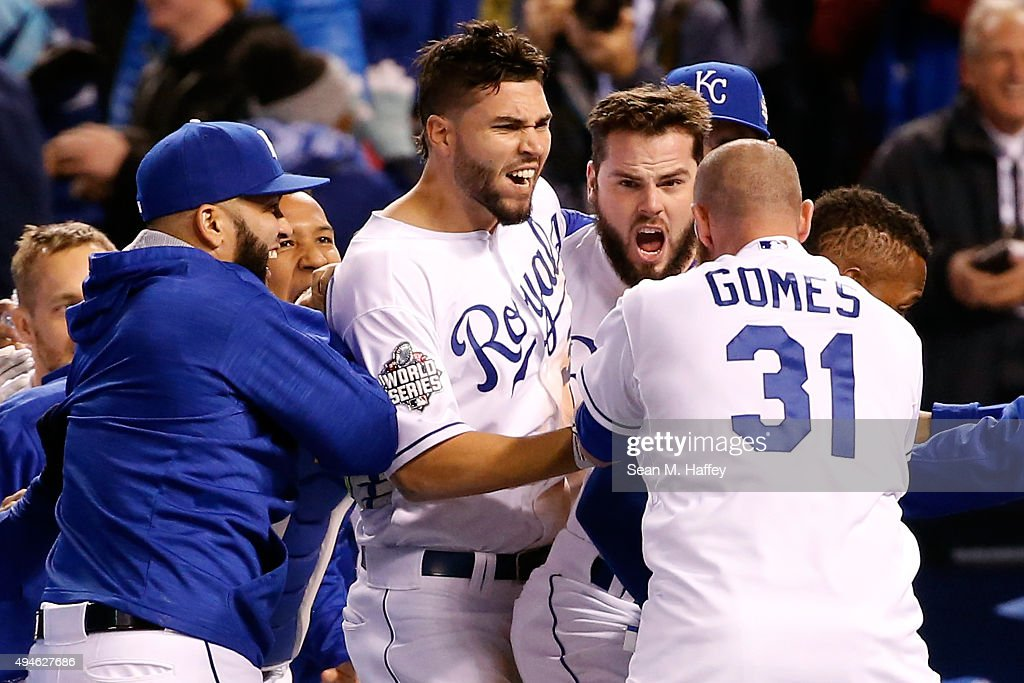 Eric Hosmer #35 of the Kansas City Royals, Mike Moustakas #8 of the Kansas City Royals, and Jonny Gomes #31 of the Kansas City Royals celebrate defeating the New York Mets 5-4 in Game One of the 2015 World Series at Kauffman Stadium on October 27, 2015 in Kansas City, Missouri.
