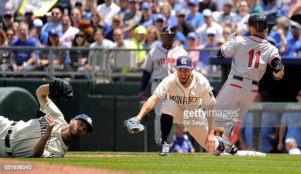 Eric Hosmer of the Kansas City Royals reacts after Danny Duffy made a diving throw to first to get the out on Ender Inciarte of the Atlanta Braves in...