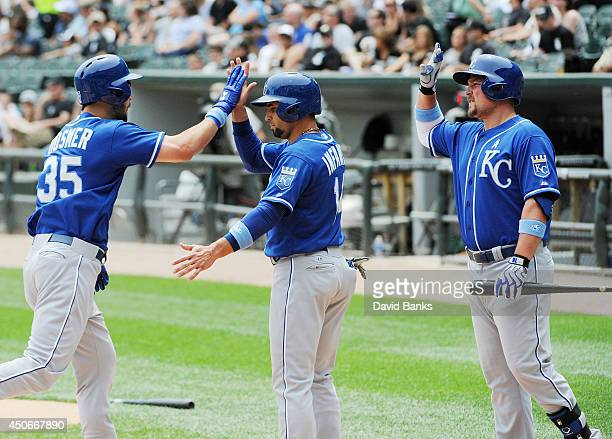 Eric Hosmer of the Kansas City Royals ris greeted by Omar Infante and Billy Butler after hitting a tworun homer against the Chicago White Sox during...