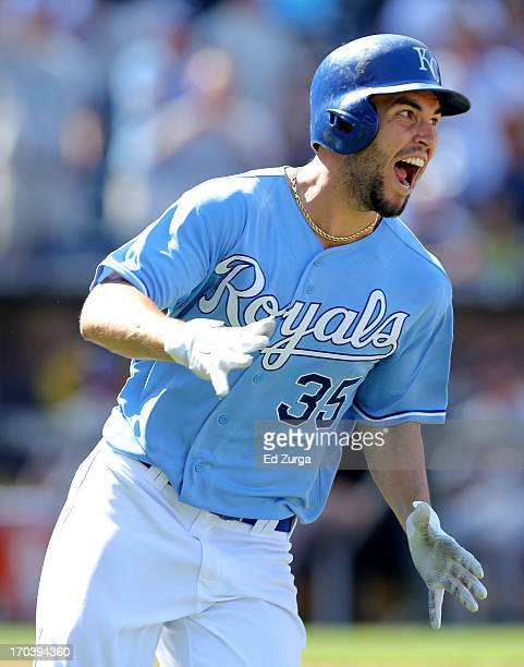 Eric Hosmer of the Kansas City Royals rounds first as he celebrates his game-winning RBI single in the 10th inning during a game against the Detroit...