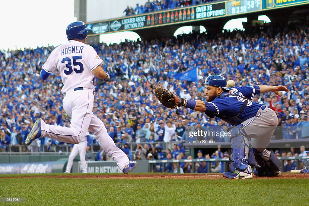 Eric Hosmer #35 of the Kansas City Royals scores a run as Russell Martin #55 of the Toronto Blue Jays is unable to make the tag in the seventh inning during game two of the American League Championship Series at Kauffman Stadium on October 17, 2015 in Kansas City, Missouri.