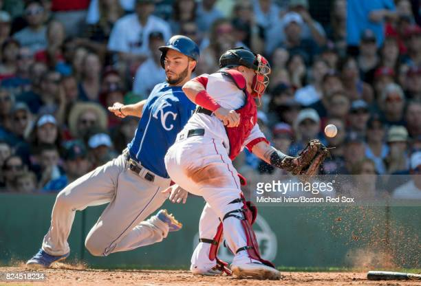Eric Hosmer of the Kansas City Royals scores ahead of a throw to Christian Vazquez of the Boston Red Sox in the eighth inning on July 30 2017 in...