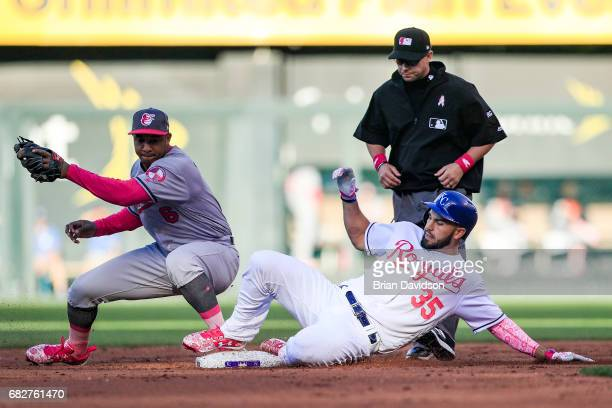 Eric Hosmer of the Kansas City Royals slides into second base under the tag of Jonathan Schoop of the Baltimore Orioles during the second inning at...