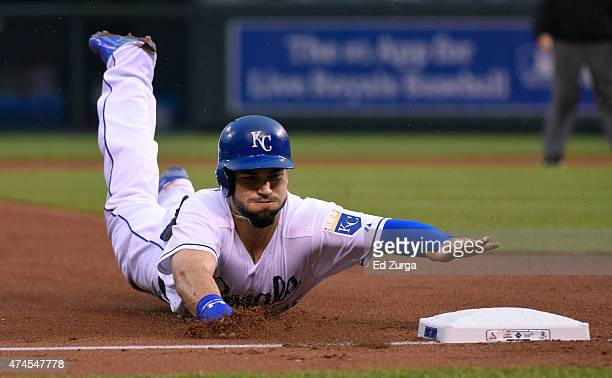 Eric Hosmer of the Kansas City Royals slides into third as he advances on a Kendrys Morales fly out in the fourth inning at Kauffman Stadium on May...