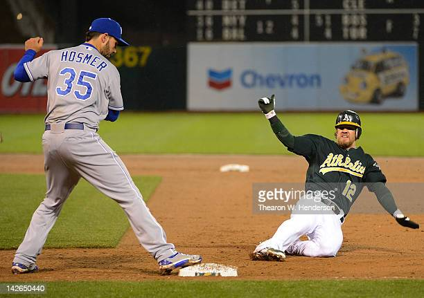 Eric Hosmer of the Kansas City Royals steps on first base doubling off Collin Cowgill of the Oakland Athletics in the second inning at Oco Coliseum...