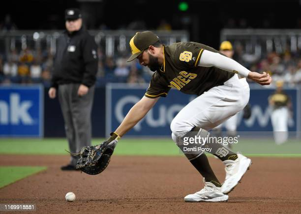 Eric Hosmer of the San Diego Padres can't make the play on a ball hit by Josh Rojas of the Arizona Diamondbacks during the seventh inning of a...