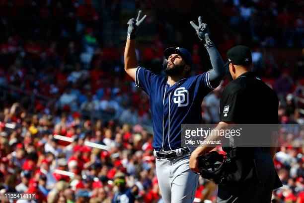 Eric Hosmer of the San Diego Padres celebrates after hitting a home run against the St Louis Cardinals in the seventh inning at Busch Stadium on...