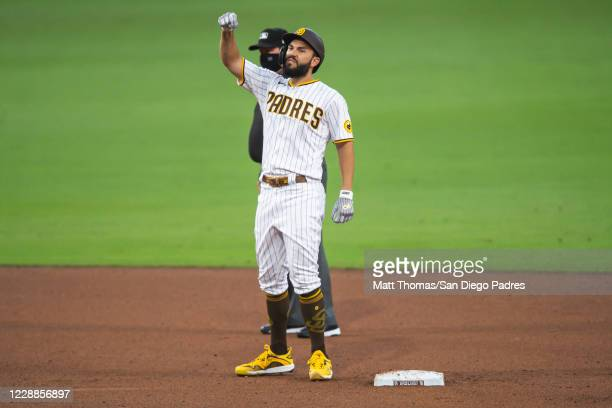 Eric Hosmer of the San Diego Padres celebrates after hitting a RBI double in the bottom of the fifth inning against the St Louis Cardinals during...