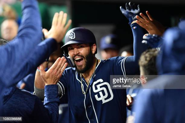 Eric Hosmer of the San Diego Padres celebrates in the dugout after hitting a ninth inning home run against the Cincinnati Reds at Great American Ball...