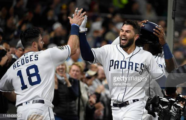 Eric Hosmer of the San Diego Padres is congratulated by Austin Hedges after hitting a tworun home run during the sixth inning of a baseball game...