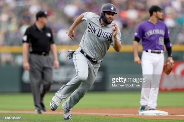 Eric Hosmer of the San Diego Padres rounds third base to score on a Manny Machado single in the first inning against the Colorado Rockies at Coors...