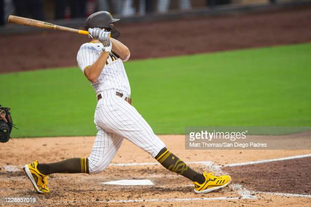 Eric Hosmer of the San Diego Padres swings and hits a RBI double in the bottom of the fifth inning against the St Louis Cardinals during Game Three...