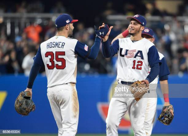 Eric Hosmer of the United States and Nolan Arenado celebrate after beating Venezuela 42 in the World Baseball Classic Pool F Game Two at PETCO Park...