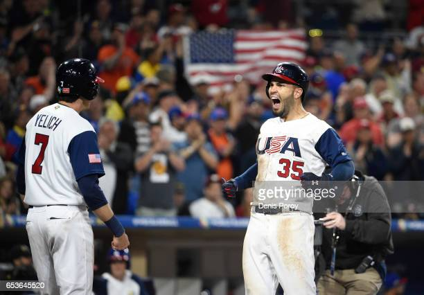 Eric Hosmer of the United States center celebrates with Christian Yelich after hitting a tworun home run in the eighth inning of the World Baseball...