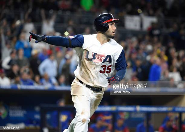 Eric Hosmer of the United States watches the flight of his tworun home run in eighth inning of the World Baseball Classic Pool F Game Two between...
