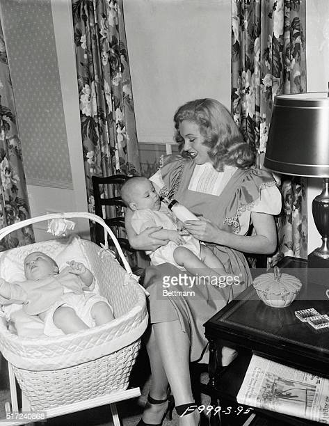 Eric isn't too keen about taking his bottle, but he is slowly succumbing to the blandishments of his charming sitter, Marilyn Monroe. Females have...