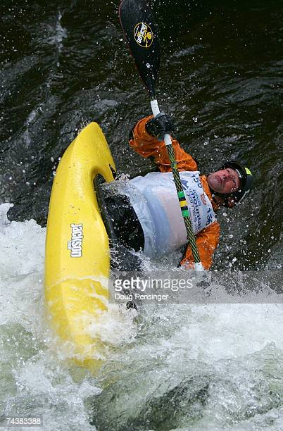 Eric Jackson of Walling, Tennessee competes during the Semi-Finals as he won the Men's Kayak Pro Freestyle at Whitewater Park on the Gore Creek...
