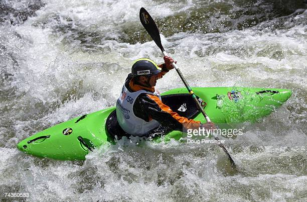 Eric Jackson pulls away from the competition in the finals as he won the Men's Dowd Chute Kayak Paddlecross on the Eagle River during the Teva...