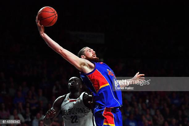 Eric Jacobsen of the Adelaide 36ers competes for the ball against Majok Majok of Melbourne United during the round two NBL match between the Adelaide...