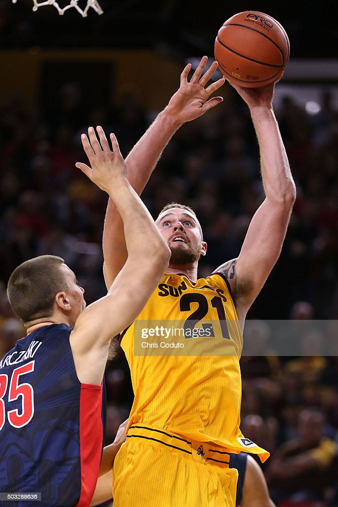 Eric Jacobsen #21 of the Arizona State Sun Devils shoots over Kaleb Tarczewski #35 of the Arizona Wildcats during the second half of the college basketball game at Wells Fargo Arena on January 3, 2016 in Tempe, Arizona. The Arizona Wildcats beat the Arizona State Sun Devils 94-82.