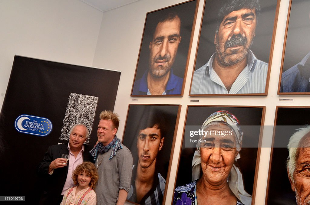 PR Eric Jacobsohn, Philipp Rathmer and his daughter attend the 'Five Roads Back Home' Philipp Rathmer Photo Exhibition Preview at Galerie Joseph on June 20, 2013 in Paris, France.