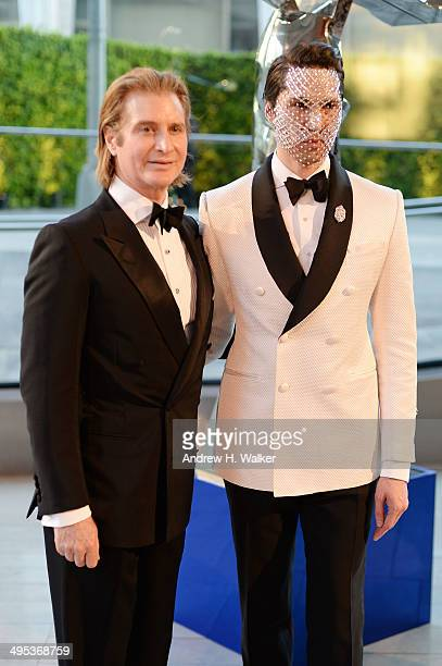 Eric Javits and Di Mondo attend the 2014 CFDA fashion awards at Alice Tully Hall Lincoln Center on June 2 2014 in New York City
