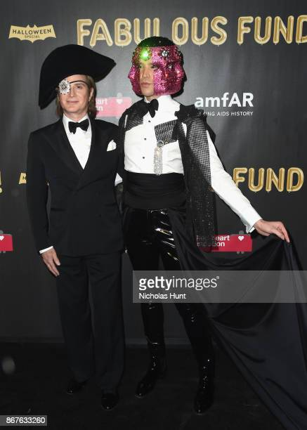 Eric Javits and Di Mondo attends the 2017 amfAR The Naked Heart Foundation Fabulous Fund Fair at Skylight Clarkson Sq on October 28 2017 in New York...