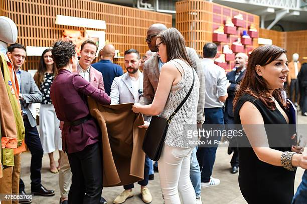 Eric Jennings guest and Claudia Cividino attended's the Bally Men's Spring Summer 2016 Presentation in Milan 21st June 2015
