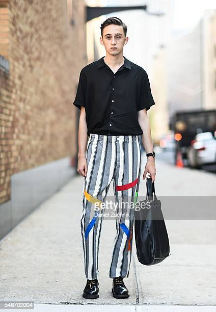 Eric Jess is seen outside the Robert Geller show wearing a Revolve shirt Sold Out pants Marc Jacobs shoes Marc Jacobs bag and a Movado watch during...