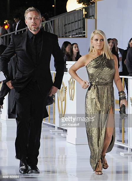 Eric Johnson and Jessica Simpson arrive at the Los Angele Premiere The Hunger Games Mockingjay Part 1 at Nokia Theatre LA Live on November 17 2014 in...