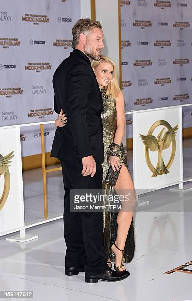 Eric Johnson and Jessica Simpson attend the Premiere of Lionsgate's The Hunger Games Mockingjay Part 1 at Nokia Theatre LA Live on November 17 2014...