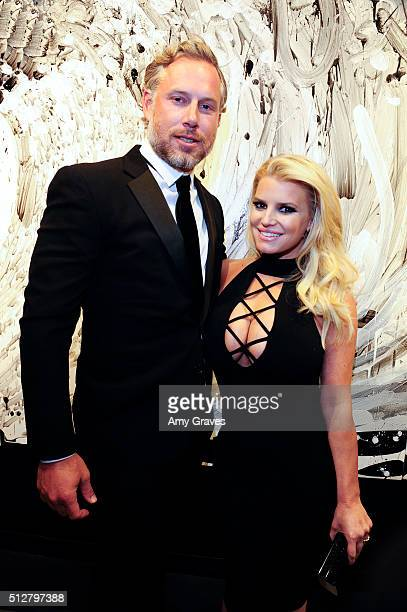Eric Johnson and Jessica Simpson attend the Tom Everhart Raw Exhibition of His Schulzinfluenced Paintings For The First Time In Black And White At...