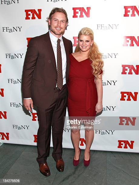 Eric Johnson and singer Jessica Simpson attend the 25th Annual Footwear News Achievement Awards at the Museum of Modern Art on November 29 2011 in...