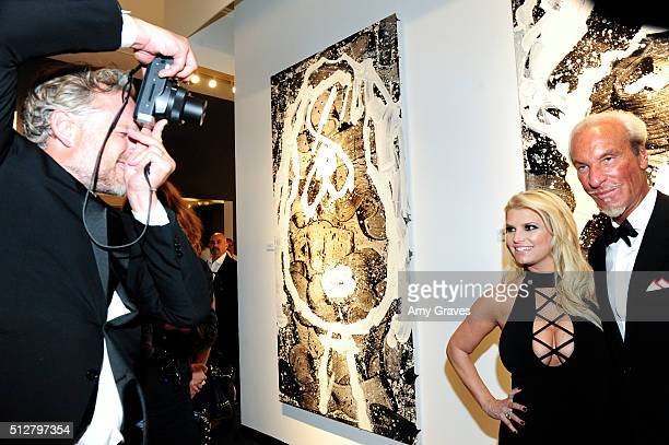 Eric Johnson Jessica Simpson and Tom Everhart attends the Tom Everhart Raw Exhibition of His Schulzinfluenced Paintings For The First Time In Black...