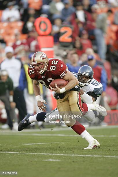 Eric Johnson of the San Francisco 49ers runs with the ball against the Seattle Seahawks at Monster Park on November 7, 2004 in San Francisco,...
