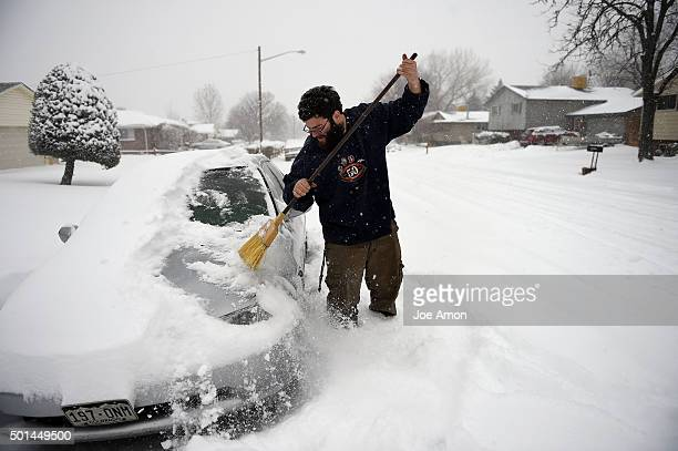 Eric Johnson out early sweeping his car in Arvada after an overnight snowfall Arvada CO December 15 2015