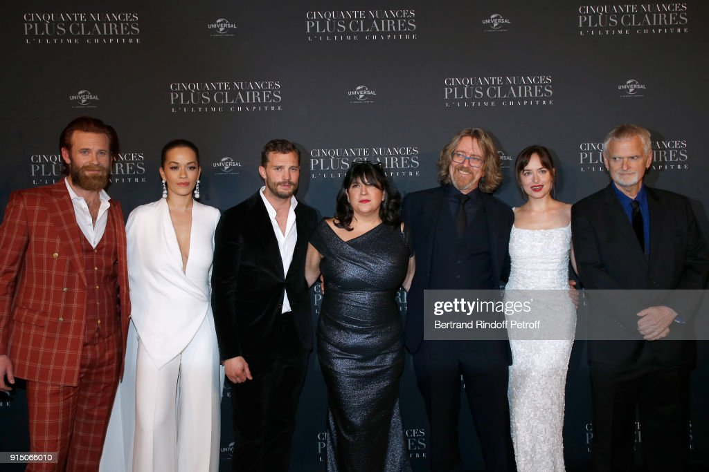 Eric Johnson, Rita Ora, Jamie Dornan, E.L. James, a guest, Dakota Johnson and James Foley attend the 'Fifty Shades Freed - 50 Nuances Plus Clair' Paris Premiere at Salle Pleyel on February 6, 2018 in Paris, France.